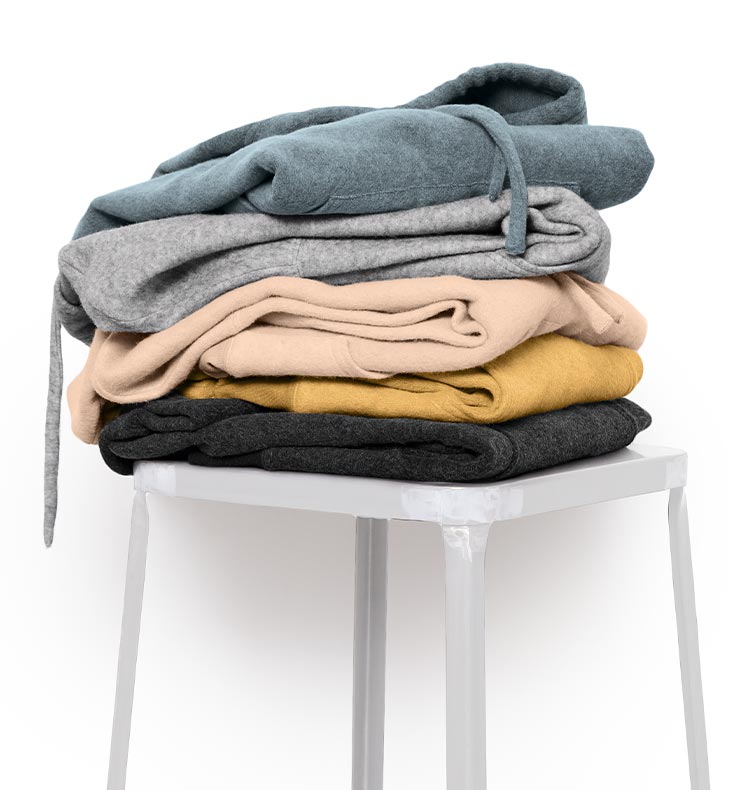 Stool with hoodies piled on top
